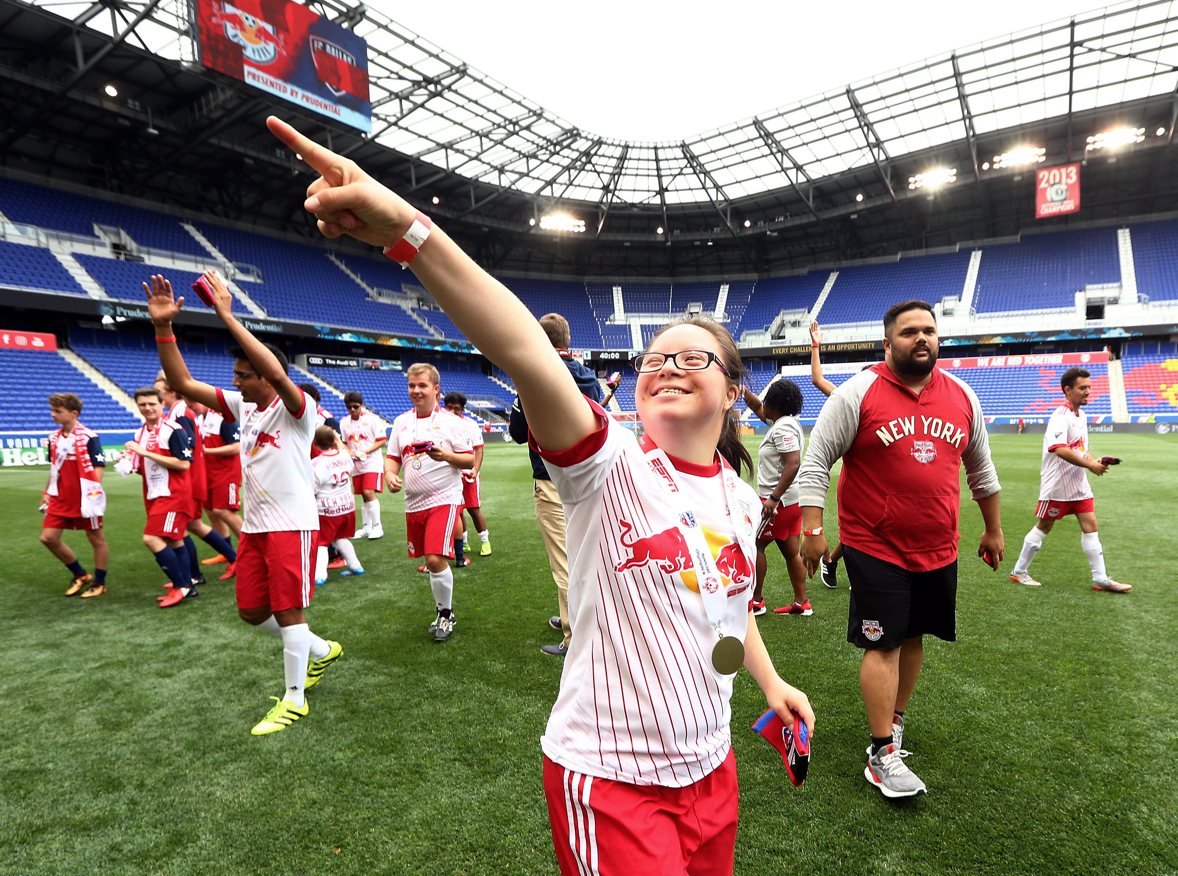 Special Olympics athlete Mai Vy Nguyen of Old Bridge playing for the Red Bulls Unified soccer team points to her family in the stands after their game vs. FC Dallas at the Red Bull Arena. June 23, 2018. Harrison, NJ