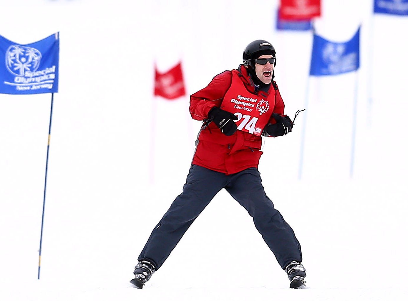 Special Olympics athlete Kevin Ritter of Eden Adult Services celebrates after finishing the Giant Slalom at Mountain Creek during the Special Olympics New Jersey Winter Games. February 6, 2018. Vernon Twp, NJ.