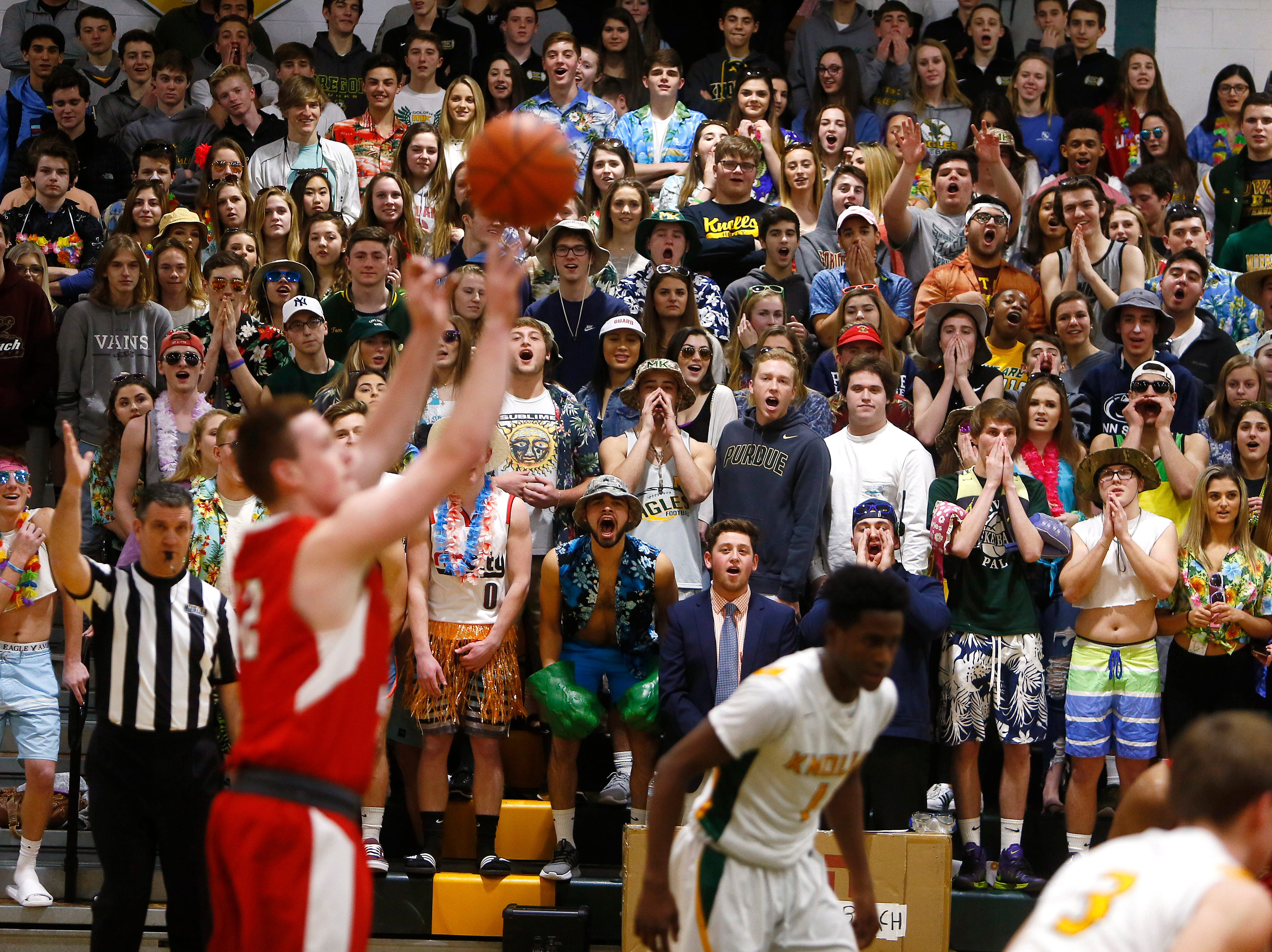 Morris Knolls fans cheer on their Golden Eagles trying to distract a Morris Hills free throw shooter during their boys basketball game at home. January 30, 2018. Denville, NJ.