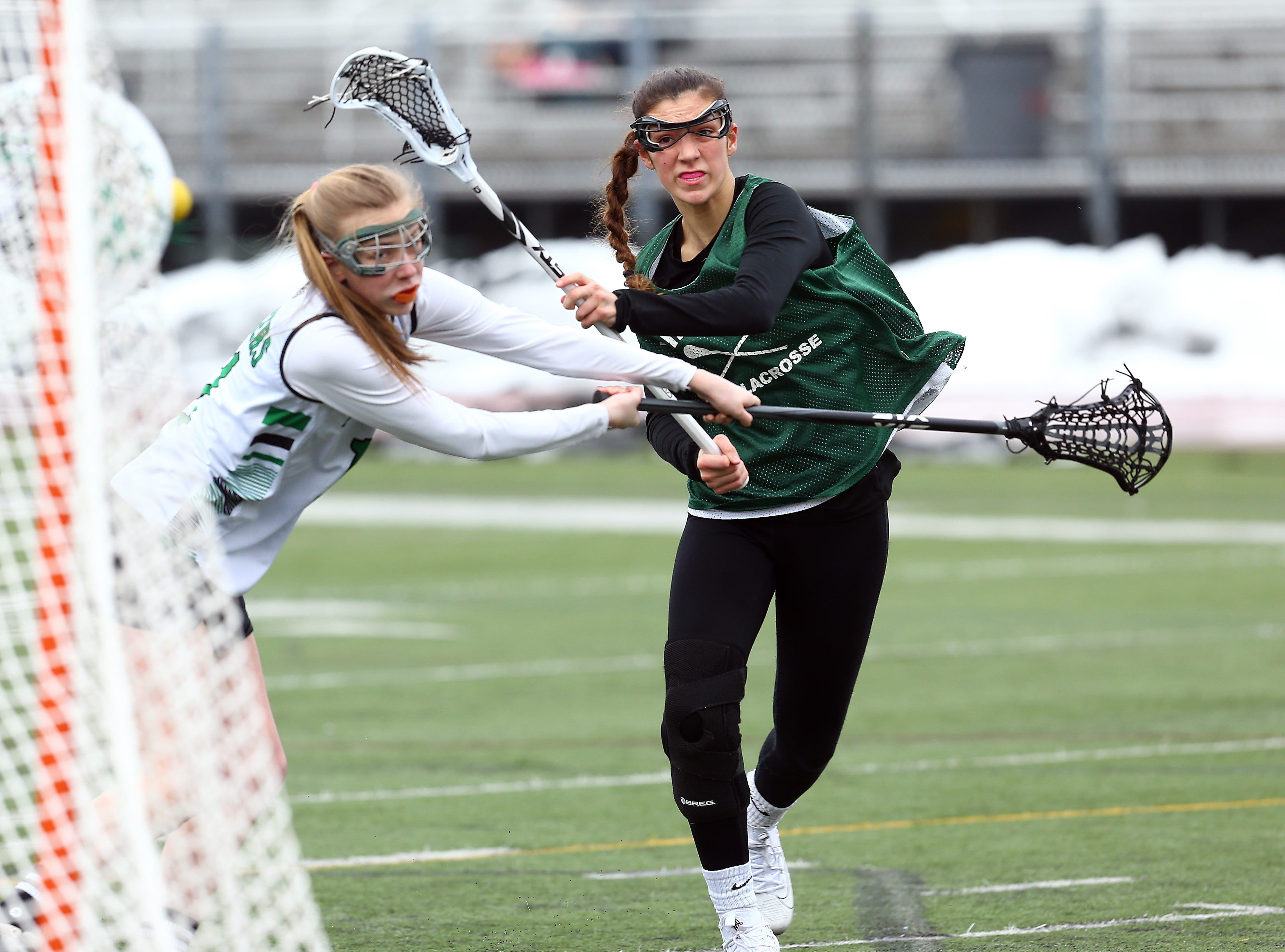 Kinnelon sophomore midfielder Taylor Smith shoots on goal vs. Livingston during their girls lacrosse scrimmage. March 23, 2018. Livingston, NJ.