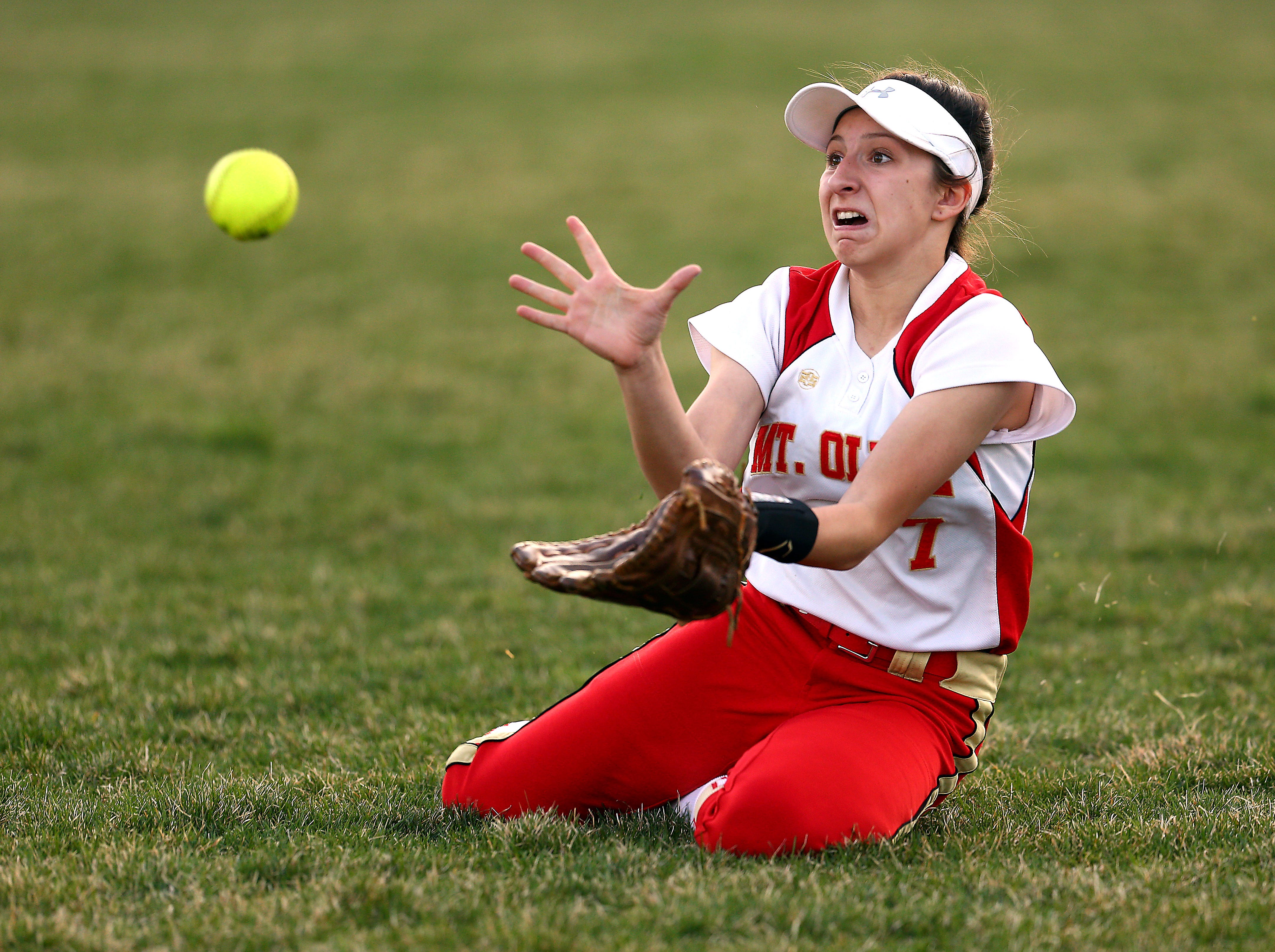 Mount Olive's Alyssa Segnello makes a diving catch vs. Hanover Park in the Morris County Tournament softball final.  May 9, 2018. Landing, NJ