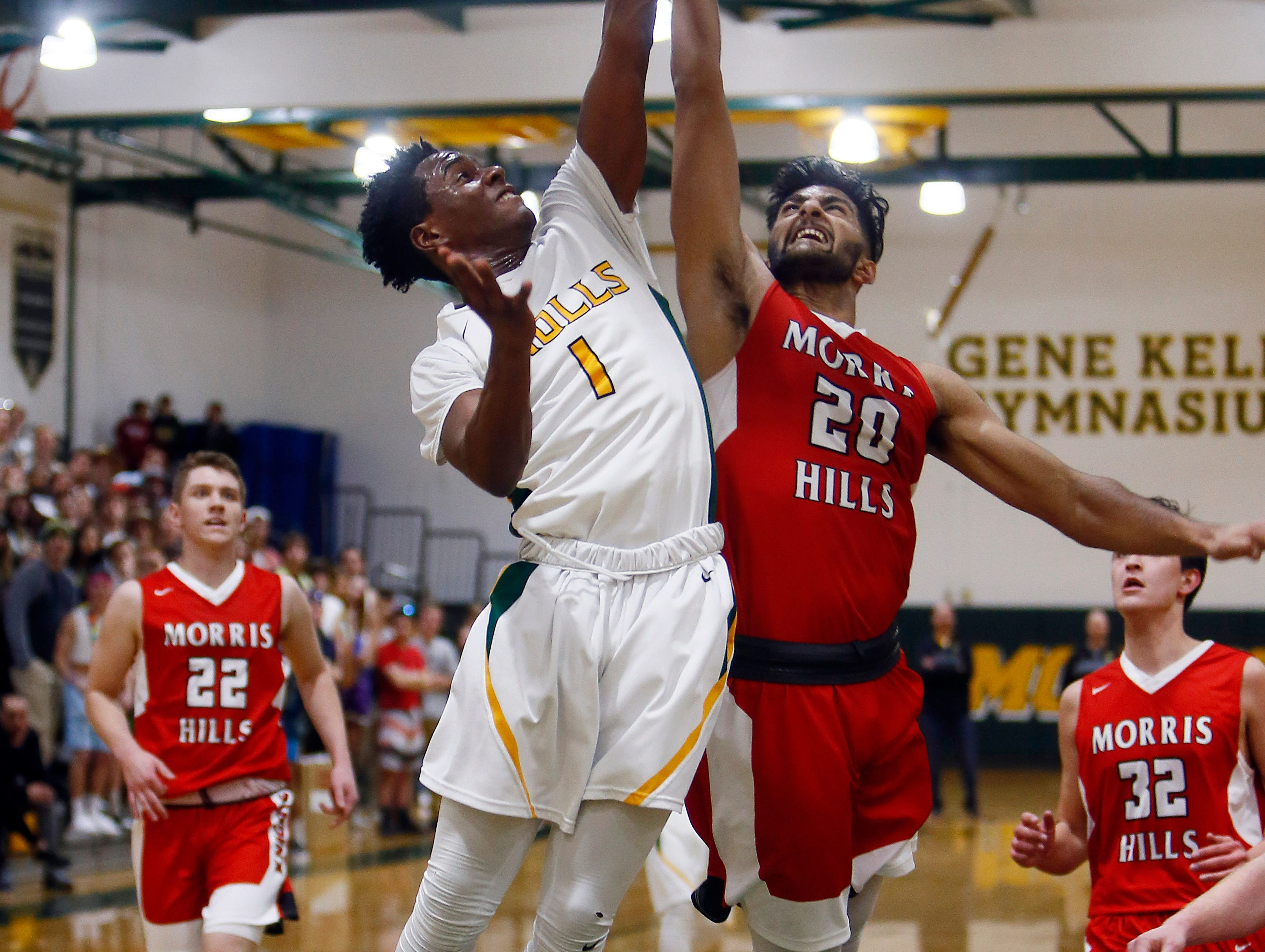 Morris Knolls Kareem Paton goes to the hoop for two, fouled by Morris Hills Umer Khawaja during their boys basketball matchup. January 30, 2018. Denville, NJ.