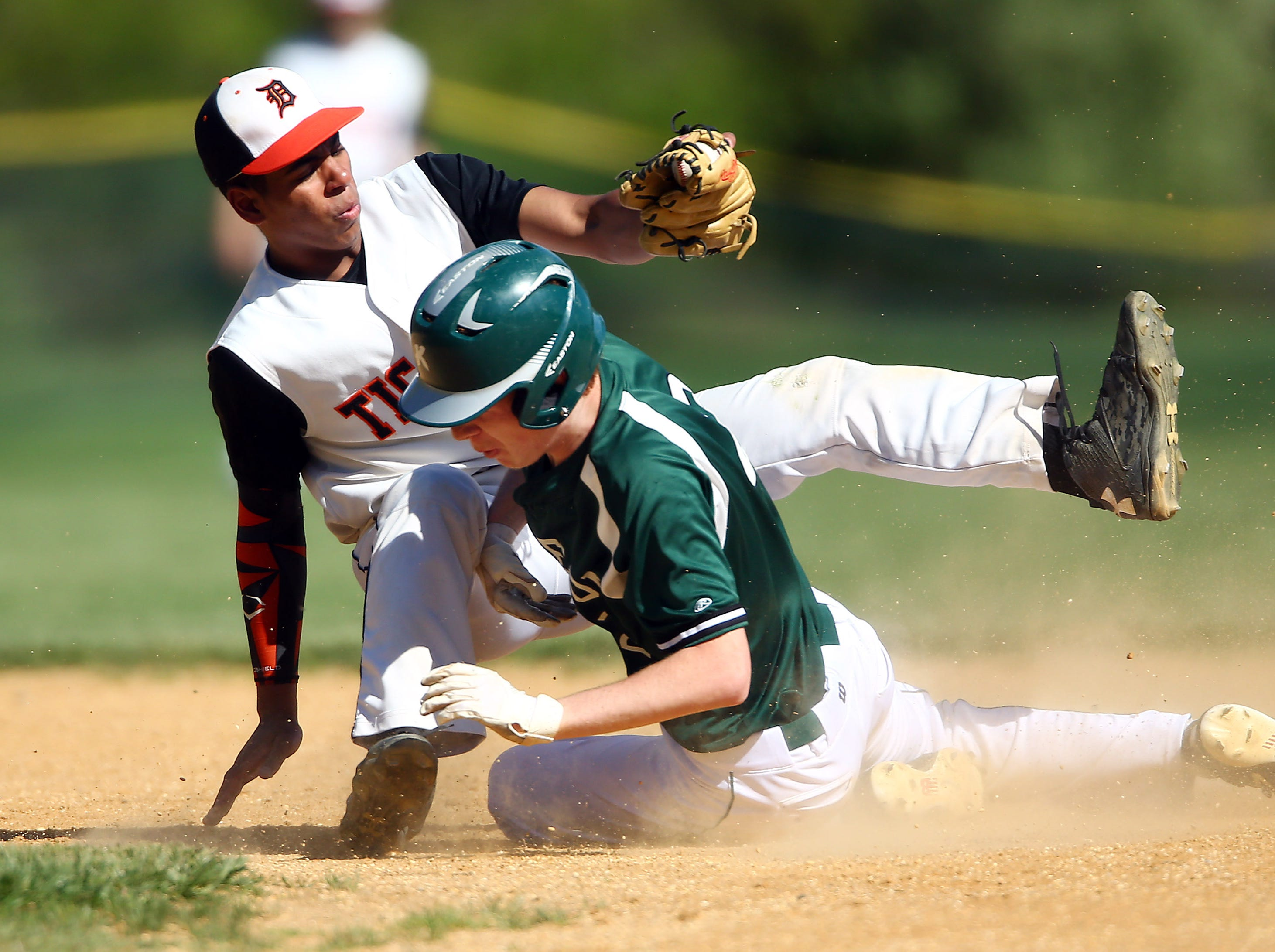 Kinnelon High School's Ben Stickle collides with Dover shortstop Josh Blackwell but is tagged out on a first inning steal. May 11, 2018. Dover, NJ