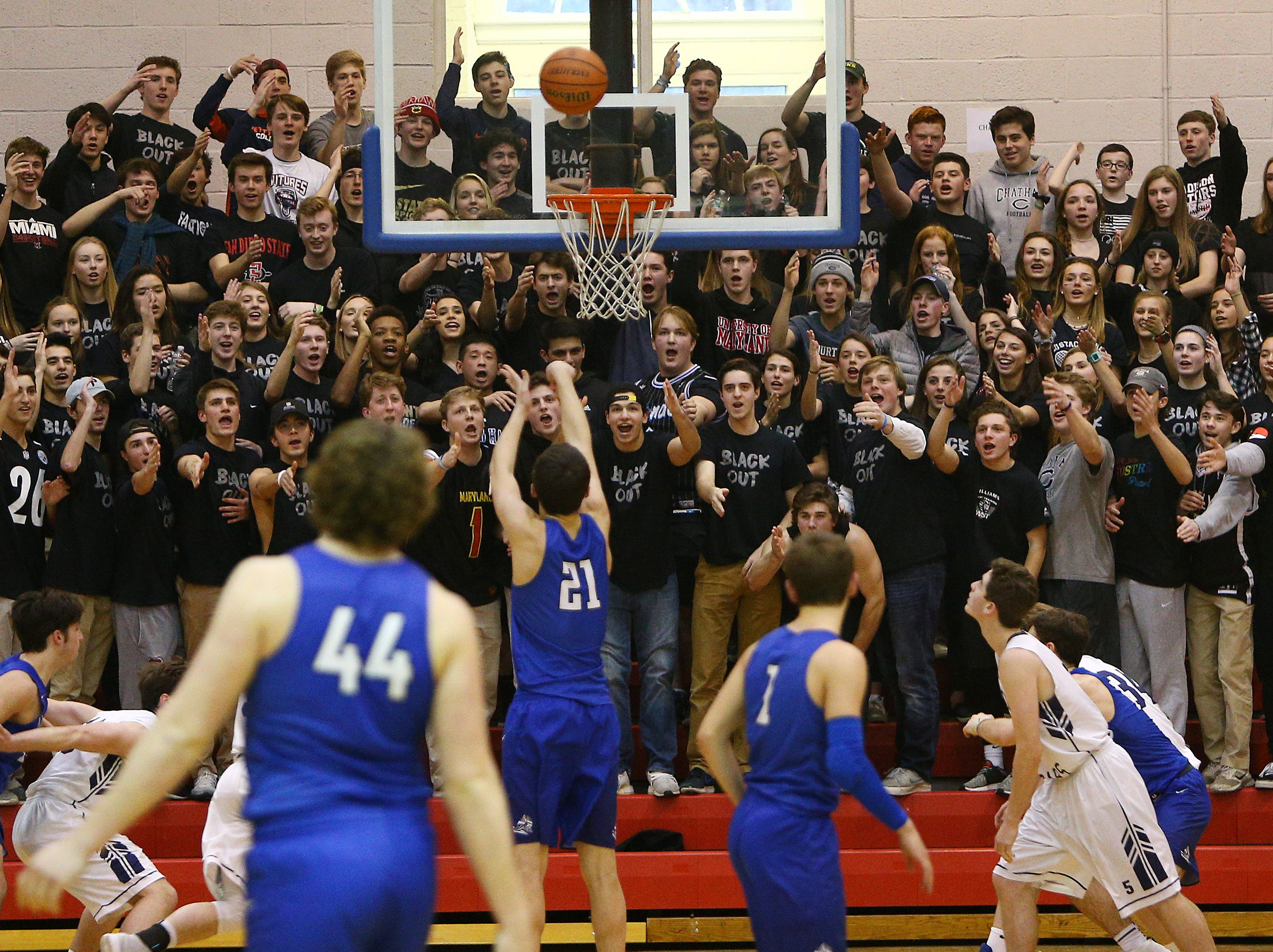 Chatham Fans try to distract free-throw shooting Jake Runyon of Demarest during the Group III boys basketball semifinal at East Orange Campus High School. The Cougars won 45-43 to move into the finals. March 9, 2018.  East Orange, NJ.