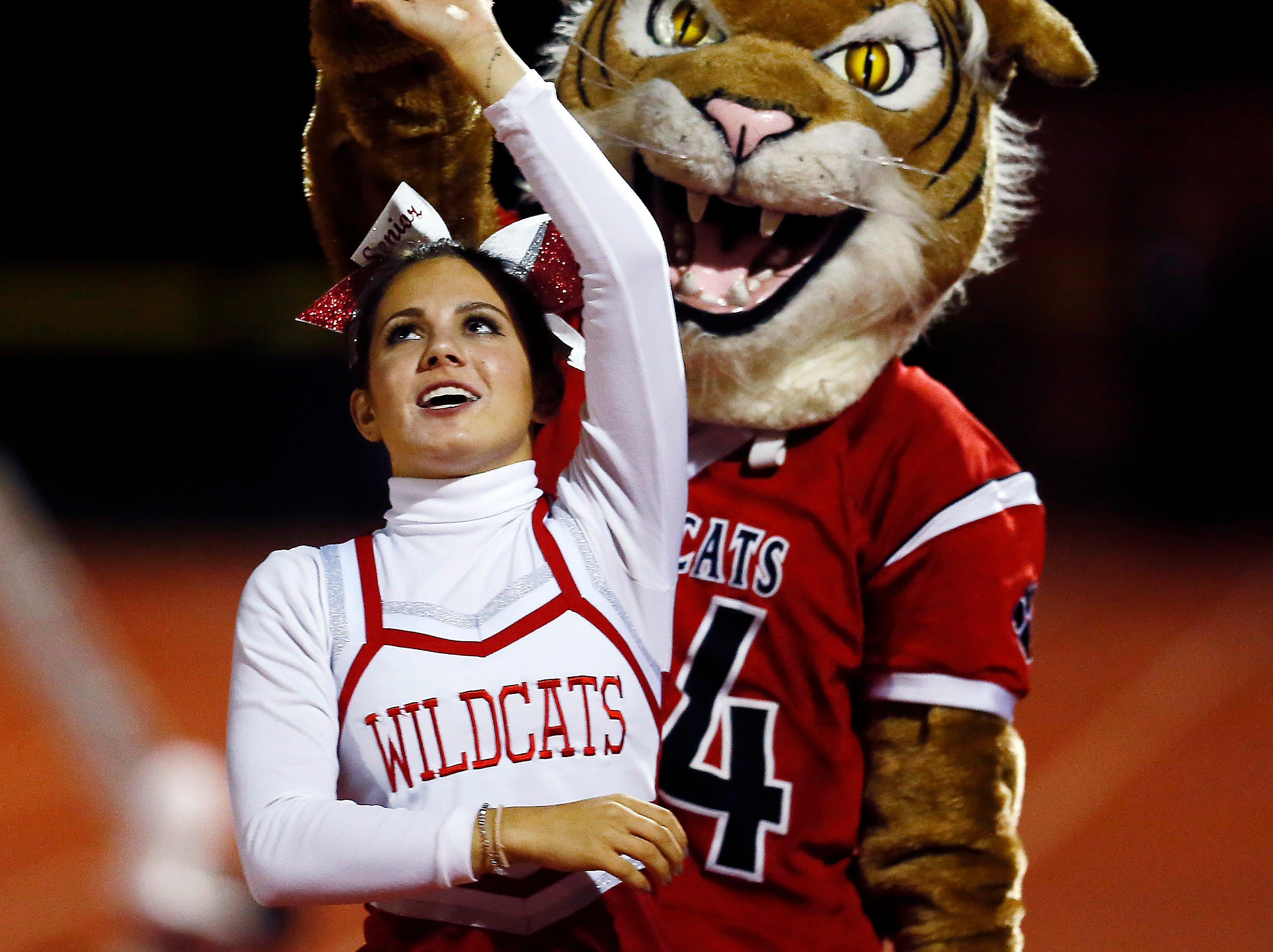 The Whippany Park Wildcat mascot dances with a cheerleader at halftime during their SFC American Blue Friday night football game vs. Boonton. September 21, 2018, Whippany, NJ