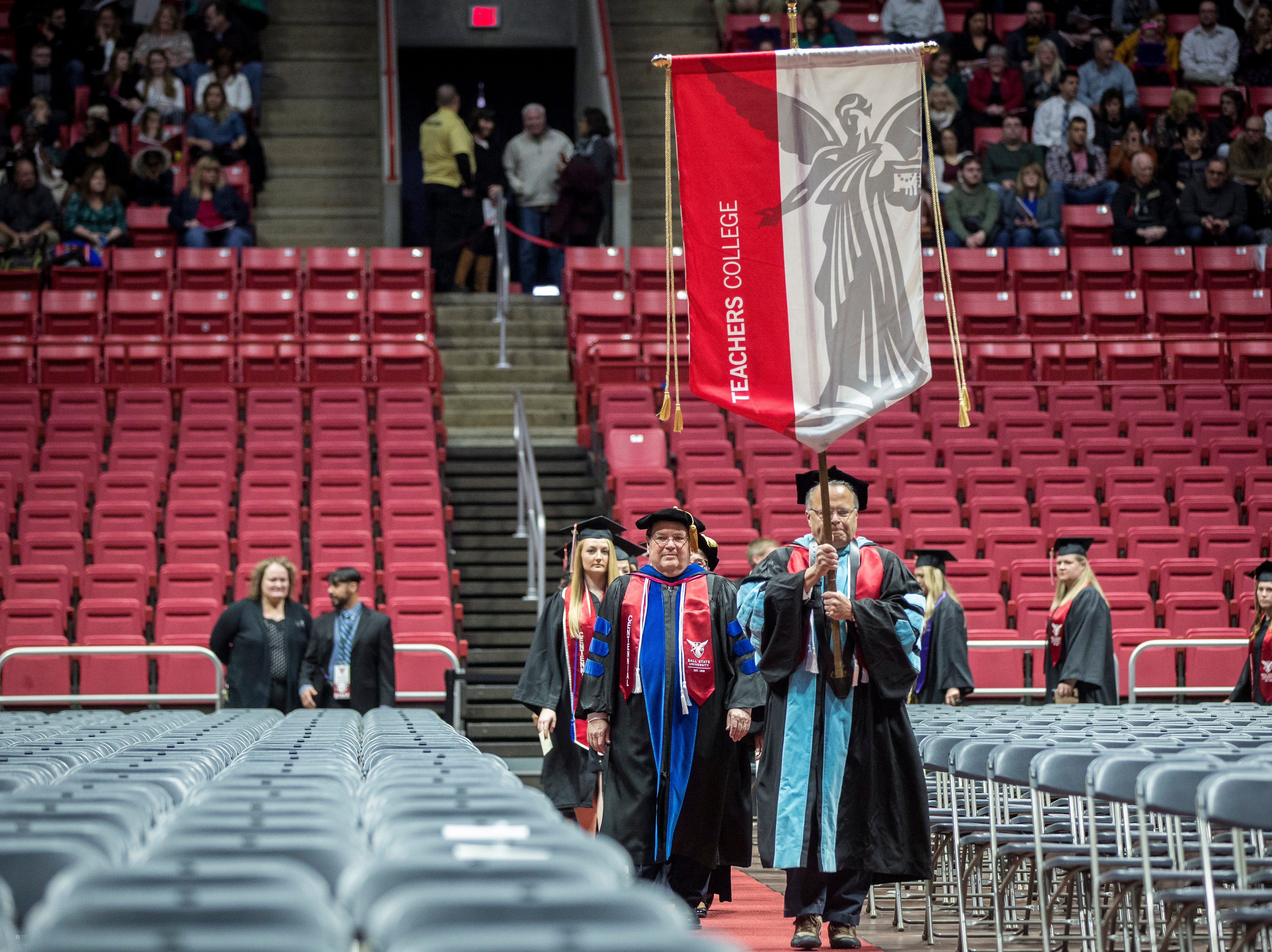 Banners lead in hundreds of students as they take part in the 184th commencement ceremony on Saturday at Worthen Arena.
