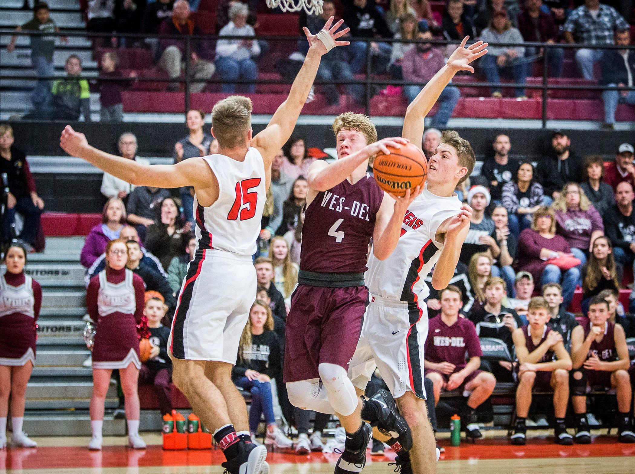 Wes-Del's Carson Ashley shoots past Wapahani's defense during their game at Wapahani High School Friday, Dec. 14, 2018.