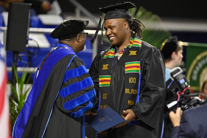 Brytavious Lakeith Chambers, professionally known as Tay Keith, accepts his diploma from MTSU President Sidney McPhee during the Fall 2018 Commencement. Tay Keith produced songs for rap artists such as Eminem and Drake while enrolled in school.