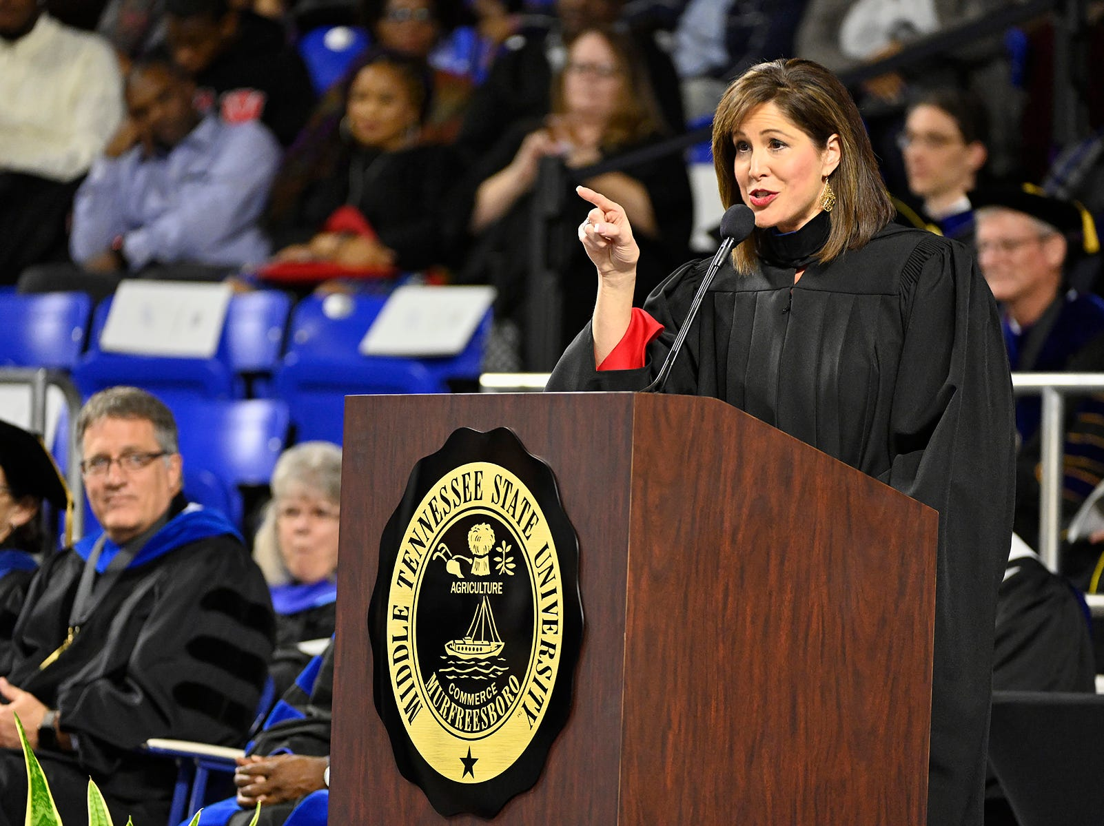 MTSU alumna Holly Thompson, a WSMV-Channel 4 news anchor, emphasizes one of her remarks Saturday, Dec. 15, during her address to graduating students at MTSU's fall 2018 afternoon commencement ceremony in Murphy Center. MTSU presented 1,731 degrees to students in dual ceremonies, including 1,471 undergraduates and 260 graduate students in the celebrations.