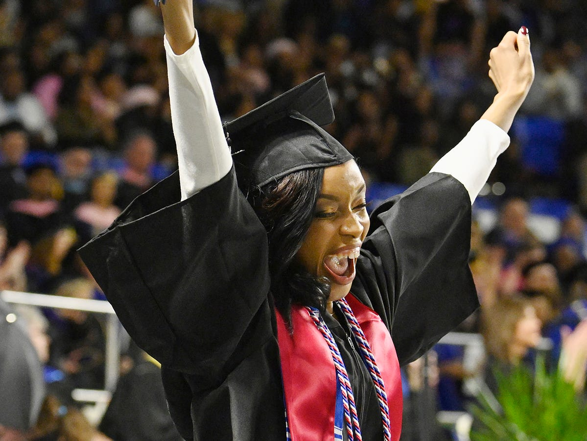 An MTSU student's exuberance and relief combine into a shout of joy as she holds her diploma aloft in Murphy Center Saturday, Dec. 15, during the university's fall 2018 afternoon commencement ceremony. MTSU presented 1,731 degrees to students in dual ceremonies, including 1,471 undergraduates and 260 graduate students in the celebrations.