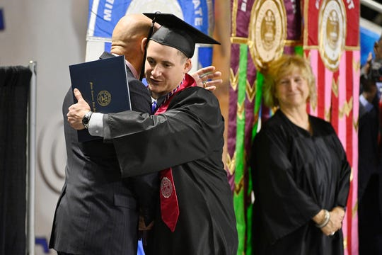 Jay Strobino, a retired soldier who was shot 13 times in one-on-one combat while serving in the U.S. Army in Iraq in 2006, receives his diploma from Middle Tennessee State University. Strobino previously received a Silver Star Medal for his valor. Now he is married and living in Nashville and working as a pharmacy technician.