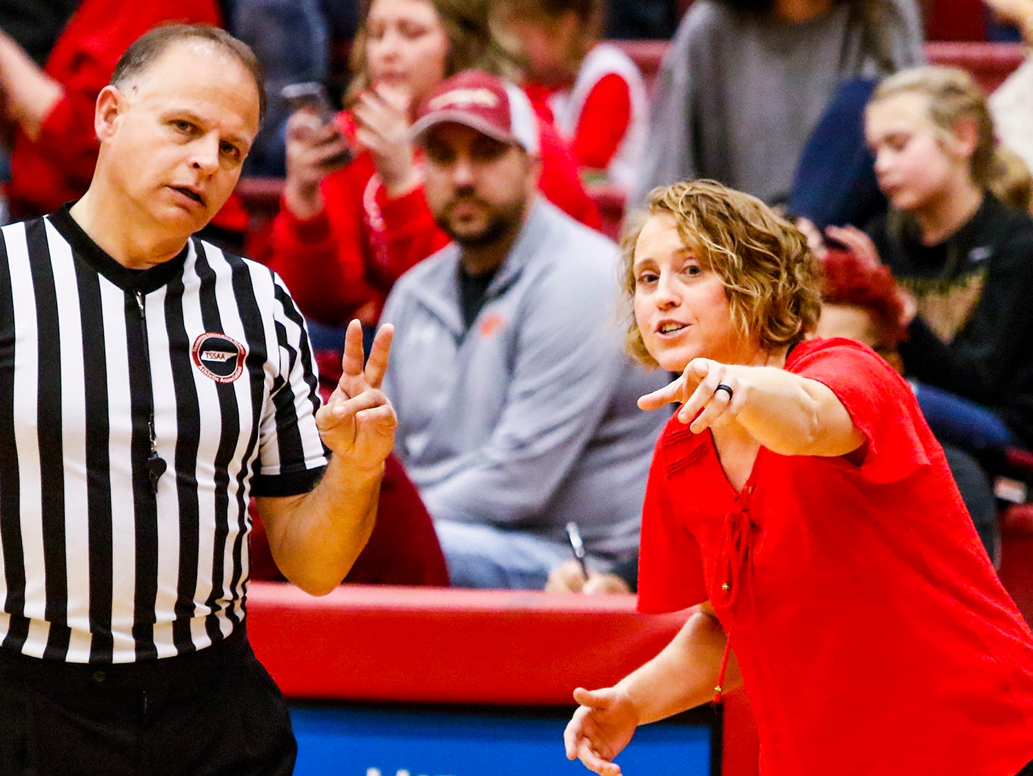 Stewarts Creek boys coach Dawn Barger discusses a call with an official.