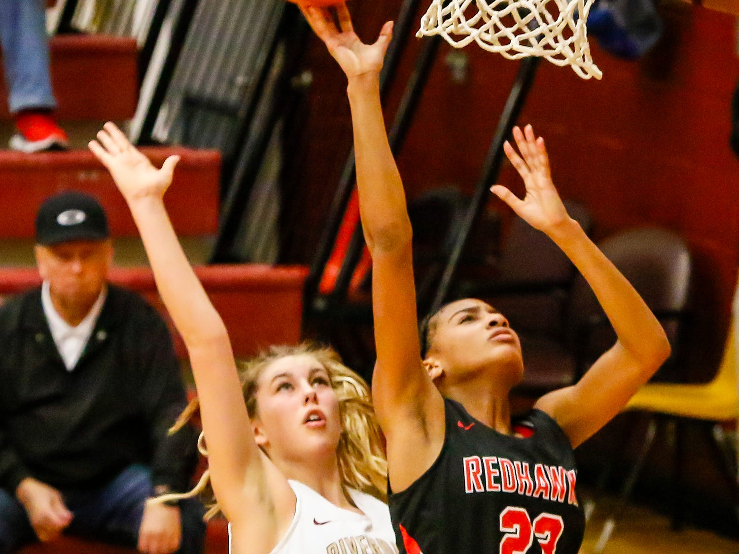 Stewarts Creek's Zhordan Shannon goes up for a layup as Riverdale's Jalyn Holcomb defends.