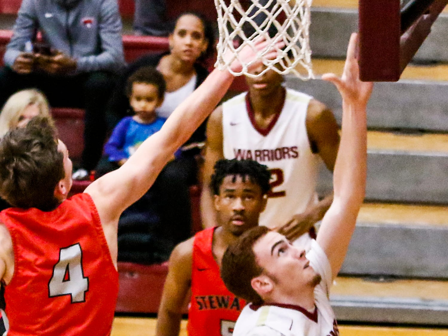 Riverdale's Preston Whittington goes up for a layup during Friday's win over Stewarts Creek.