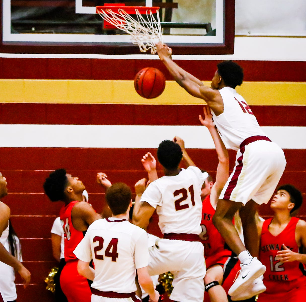 Riverdale's Elijah Cobb slams home two of his eight points during the Warriors' 73-46 win over Stewarts Creek Friday.