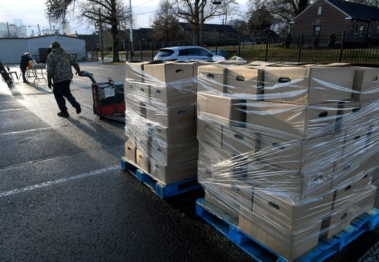 Workers unload holiday food boxes for the Rotary Club of Nashville and Second Harvest Food Bank of Middle Tennessee's 17th annual Feed the Need project which will feed over 1,900 families this holiday season.
