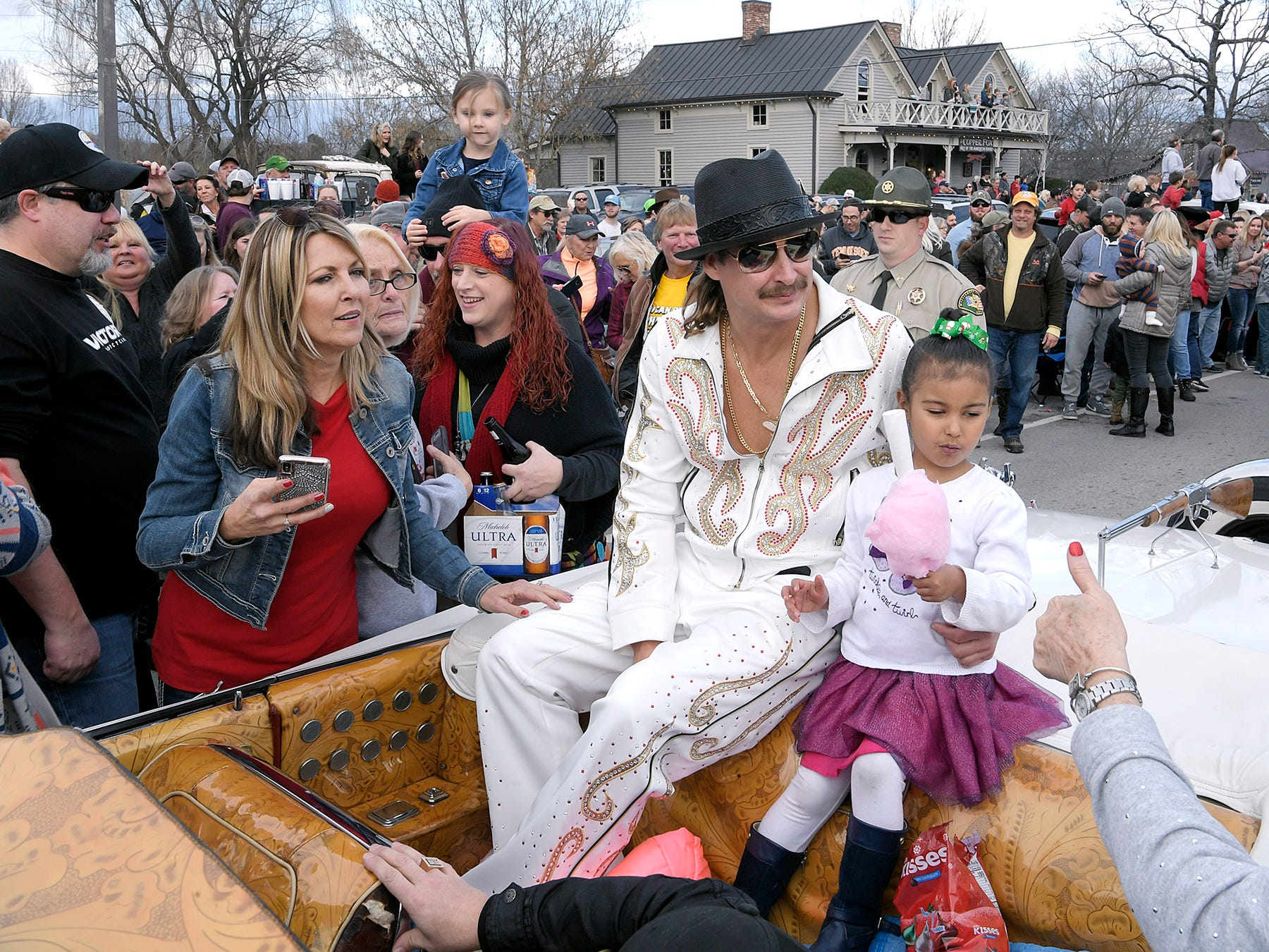 Kid Rock rides with his granddaughter in the Leipers Fork Christmas Parade on Saturday, Dec. 15, 2018.