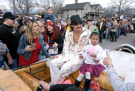 Kid Rock rides with his granddaughter in the Leipers Fork Christmas Parade in Tennessee on Dec. 15, 2018.