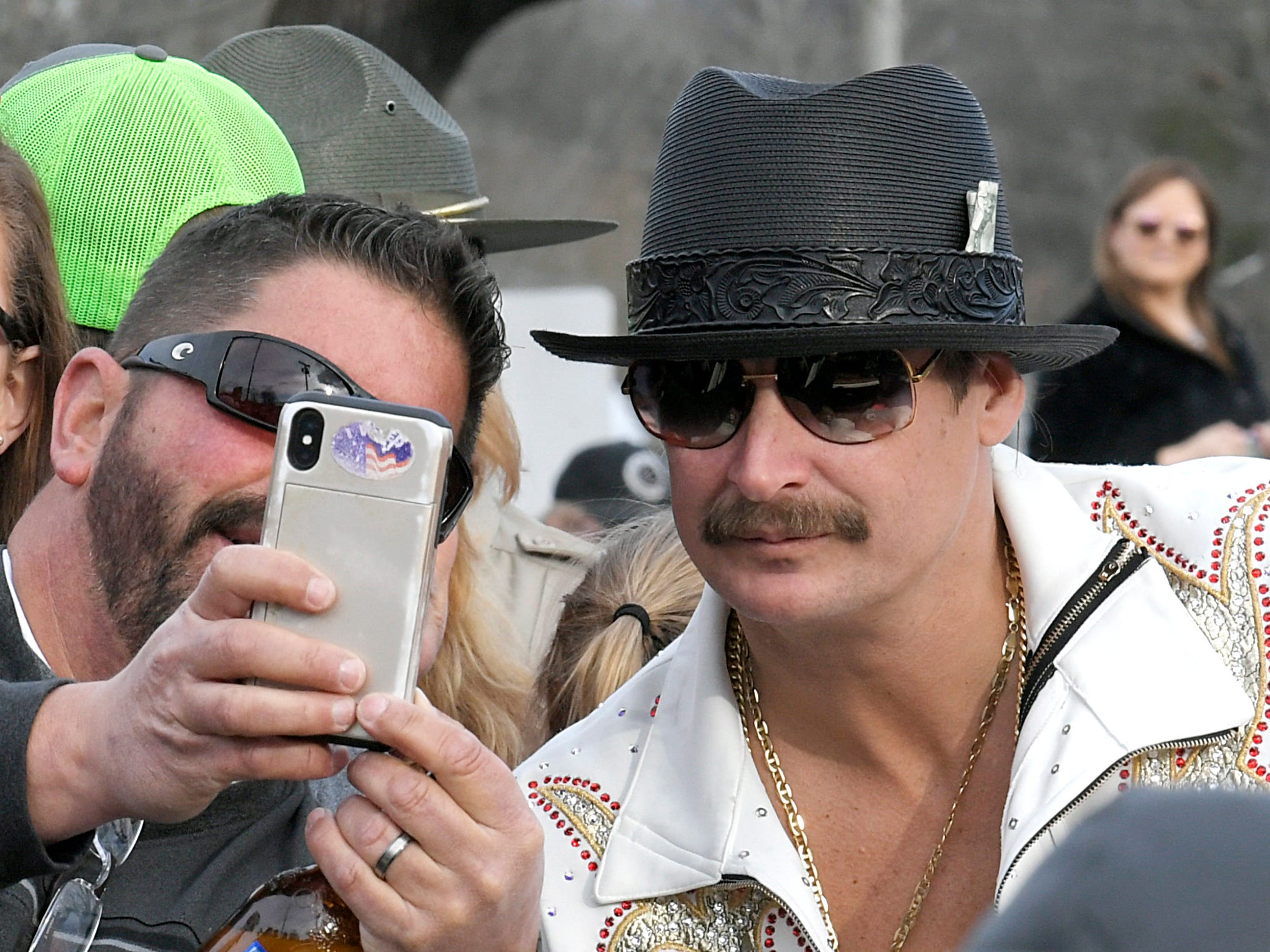 People take selfies with Kid Rock rides as he rides in the Leipers Fork Christmas Parade on Saturday, Dec. 15, 2018.