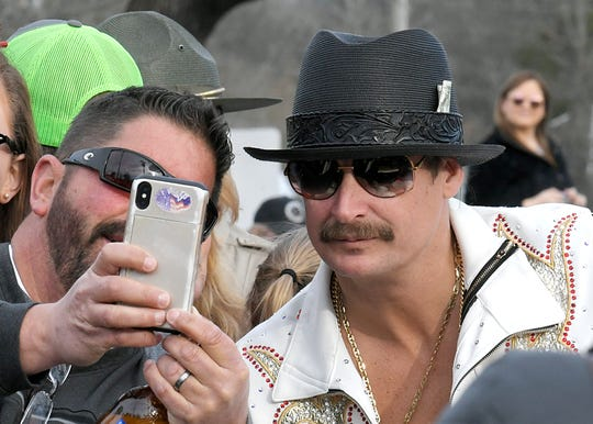 "People take selfies with Kid Rock as he rides in the Leiper's Fork Christmas Parade on Dec. 15. Kid Rock performs the duet ""Grass is Always Greener"" with Jake Owen on Owen's new album, ""Greetings ... from Jake."""