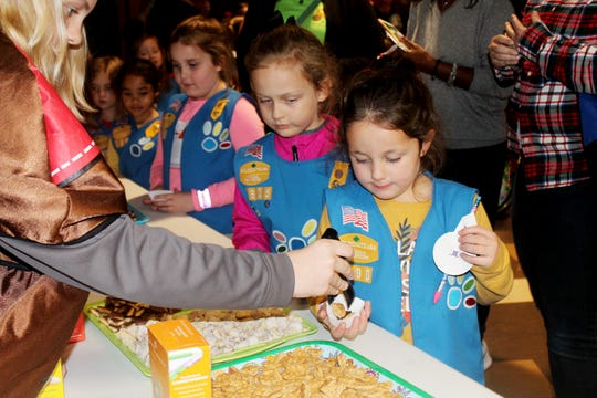 Girl Scout Daisy, Margaret Cherry, samples Girl Scout cookies at local Cookie Rally Dec. 13, 2018.