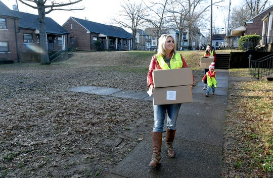 Rotary Club of Nashville member Christy Robinson and her family hlep deliver holiday food boxes to Cheatham Place residents during 17th annual Feed the Need project on Saturday Dec. 5, 2018.