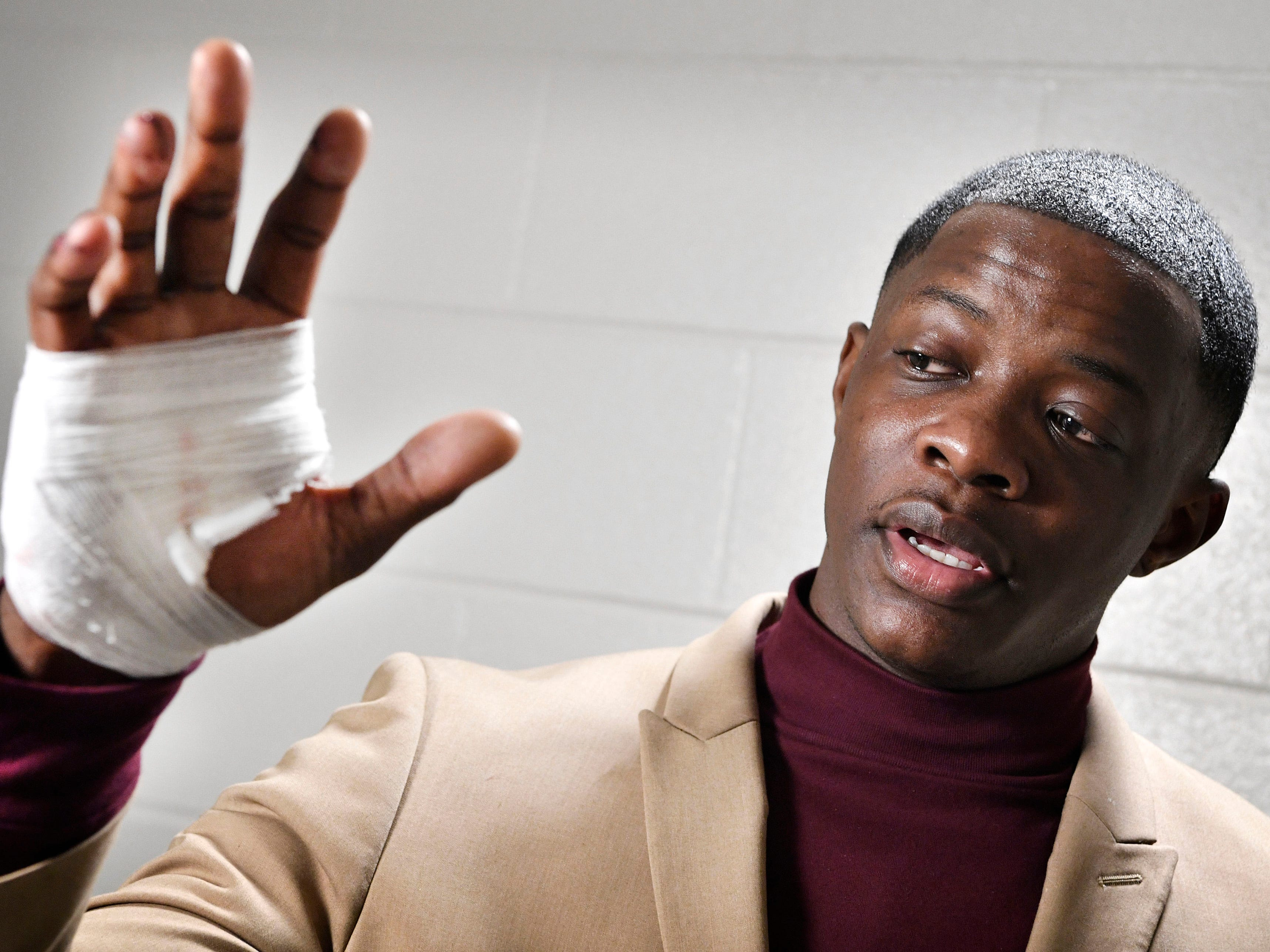 James Shaw Jr., 29, shows his hand that was injured when he disarmed a shooter inside an Antioch Waffle House, Sunday, April 22, 2018, in Nashville, Tenn