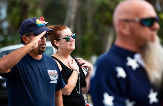 Pam Paridee of Port Charlotte pays her respects to veterans during the closing ceremony of the local Wreaths Across America ceremony hosted by the Golden Gate Veterans of Foreign Wars Post 7721 at Lake Trafford Memorial Gardens in Immokalee on Saturday, Dec. 15, 2018.