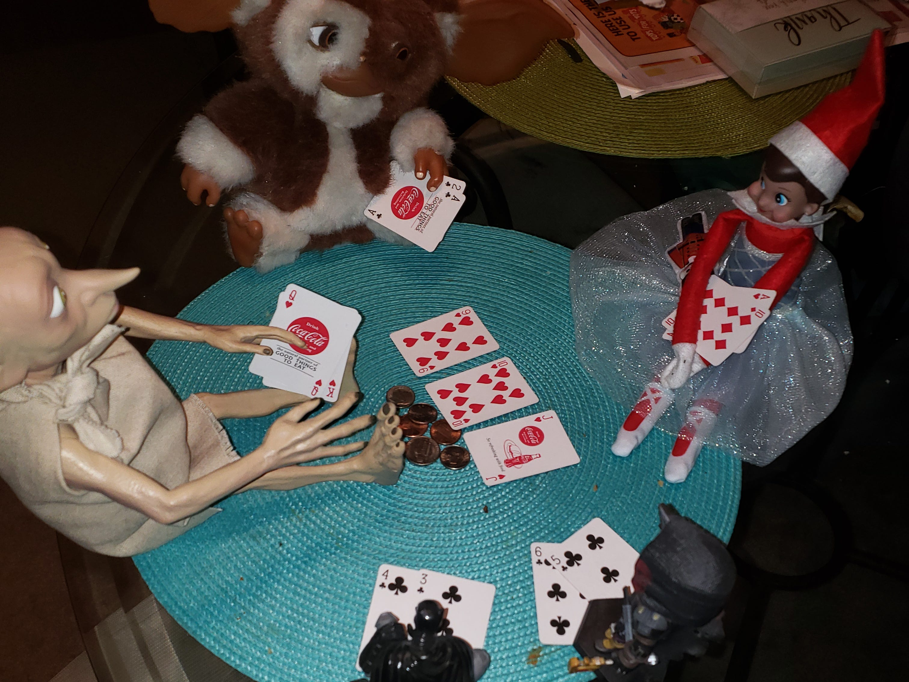 Snowflake the elf is playing poker with her friends.