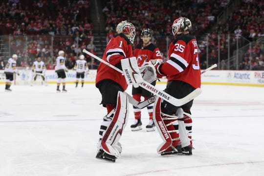 New Jersey Devils goaltender Keith Kinkaid (1) replaces Devils goaltender Cory Schneider (35) during the first period against the Vegas Golden Knights at Prudential Center.