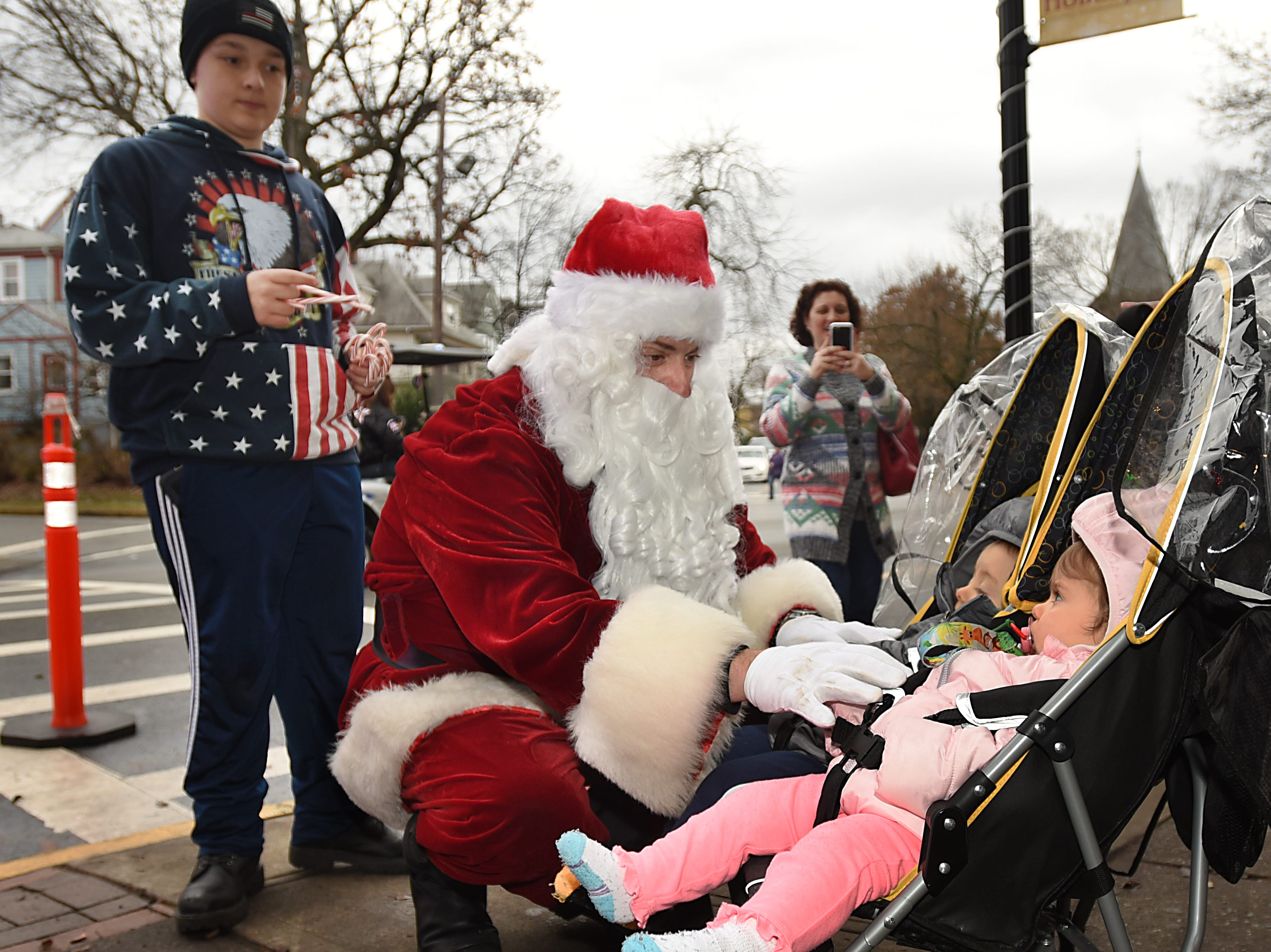 The Rutherford Fire Department escorts Santa around Rutherford on Saturday December 15, 2018. Anthony Bruno, dressed as Santa greets Victoria and Leonardo Kruss, both 11 months old.