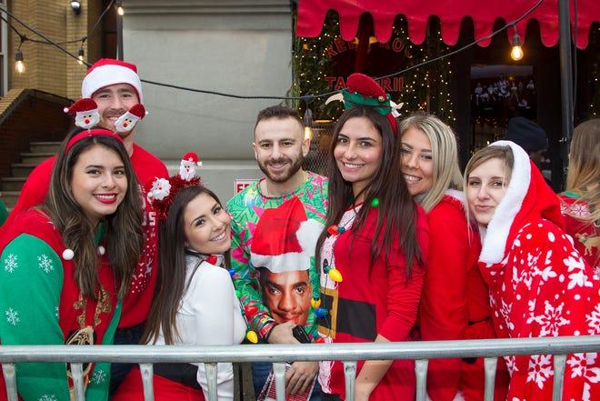2018 SantaCon in Hoboken. SantaCon is a convention  men and women dressed like Santa. 12/15/2018