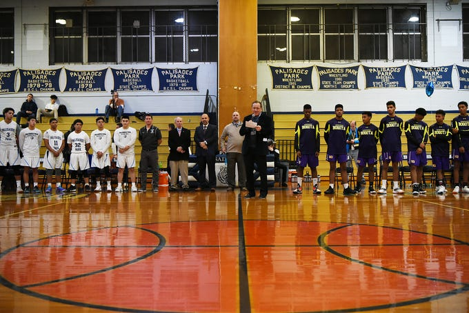 Palisades Park High School holds a ceremony to name the gym after John Wroblewski, long time athletic director on Friday December 14, 2018. Principal Frank Donohue says a few words.