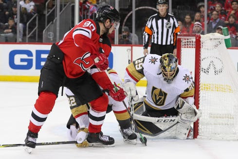 Vegas Golden Knights goaltender Marc-Andre Fleury (29) makes a save on New Jersey Devils left wing Marcus Johansson (90) during the second period at Prudential Center.