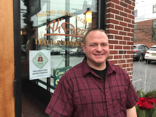 Ah'Pizz restaurant manger Danny Labat says free parking helps him keep adjoining lot open for his customers. Saturday, Dec. 15, 2018