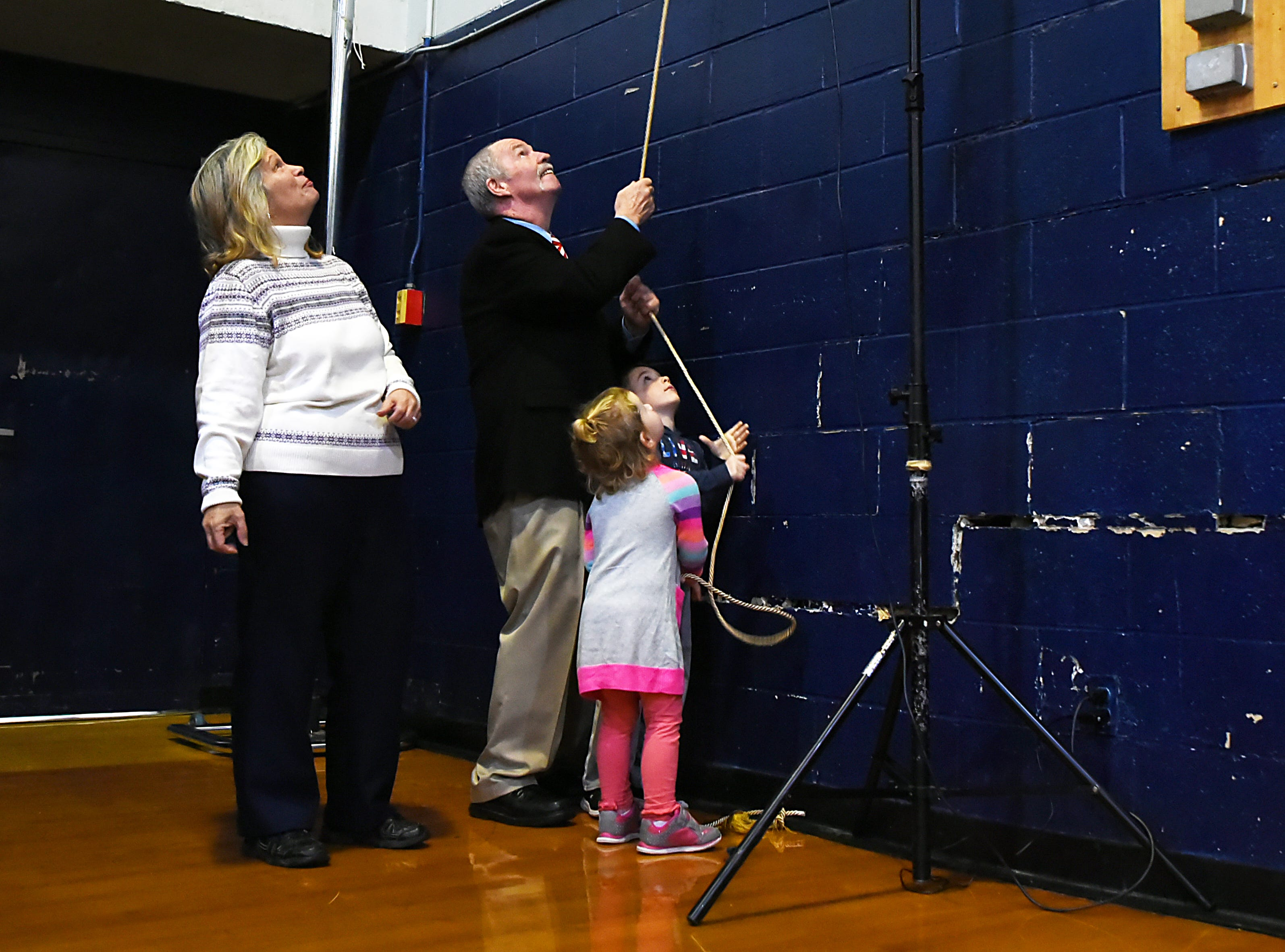Palisades Park High School holds a ceremony to name the gym after John Wroblewski, long time athletic director on Friday December 14, 2018. John Wroblewski and his grandchildren unveil the sign in the gym as his wife Shawn Wroblewski looks on.