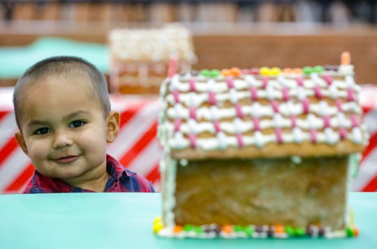 Miguel Torres, 2, of Las Cruces, is pictured before he enjoys a holiday meal on Saturday, December 15, 2018 as Oñate High School hosts families from the Community of Hope at the school. Toys, clothing and food was given during the event.