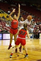 New Mexico State's Rodrea Echols penetrates the New Mexico defense for a lay up attempt on Saturday at the Pan American Center.