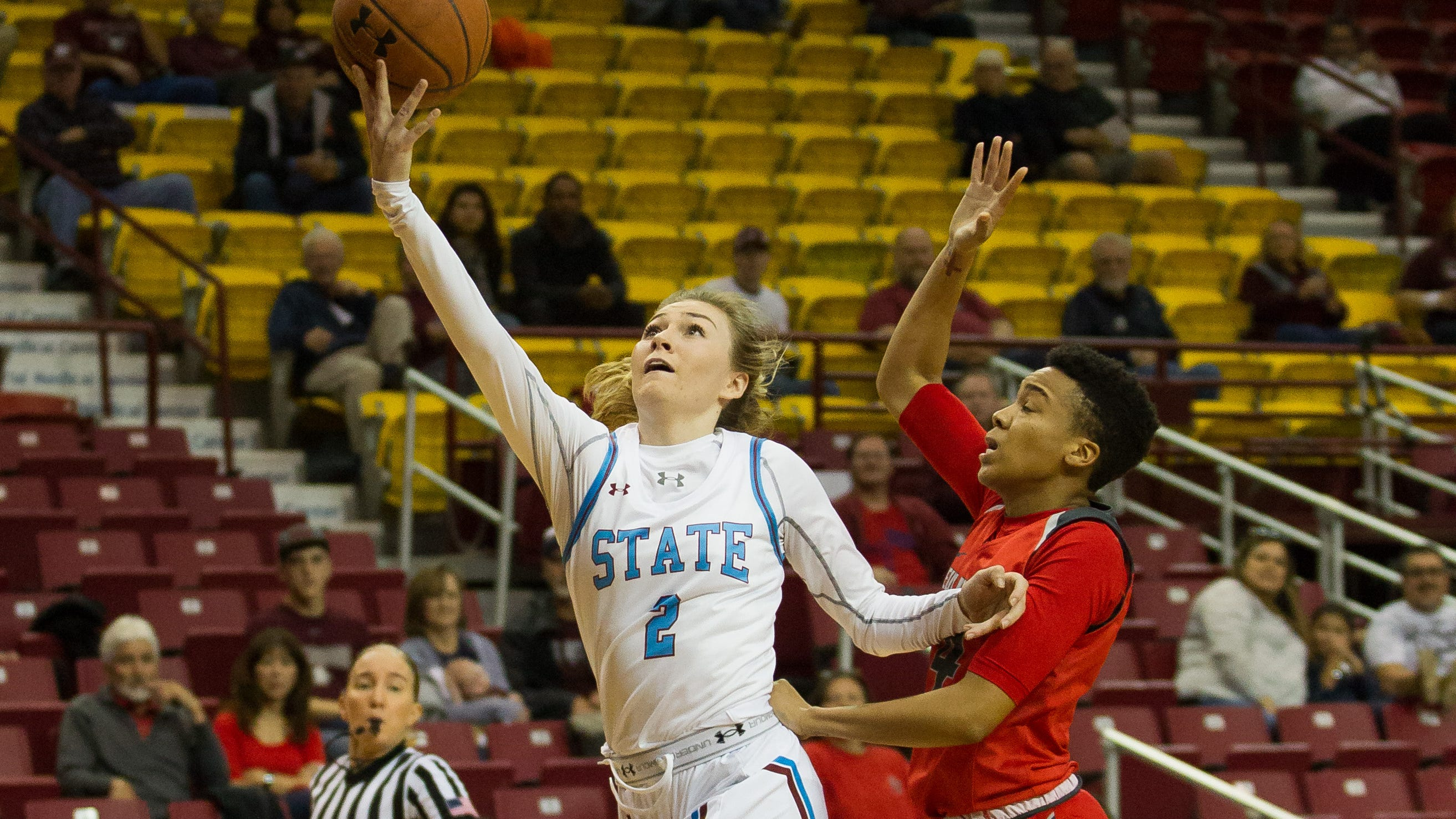 New Mexico State's Brooke Salas drives in for a lay up against New Mexico on Saturday at the Pan American Center.