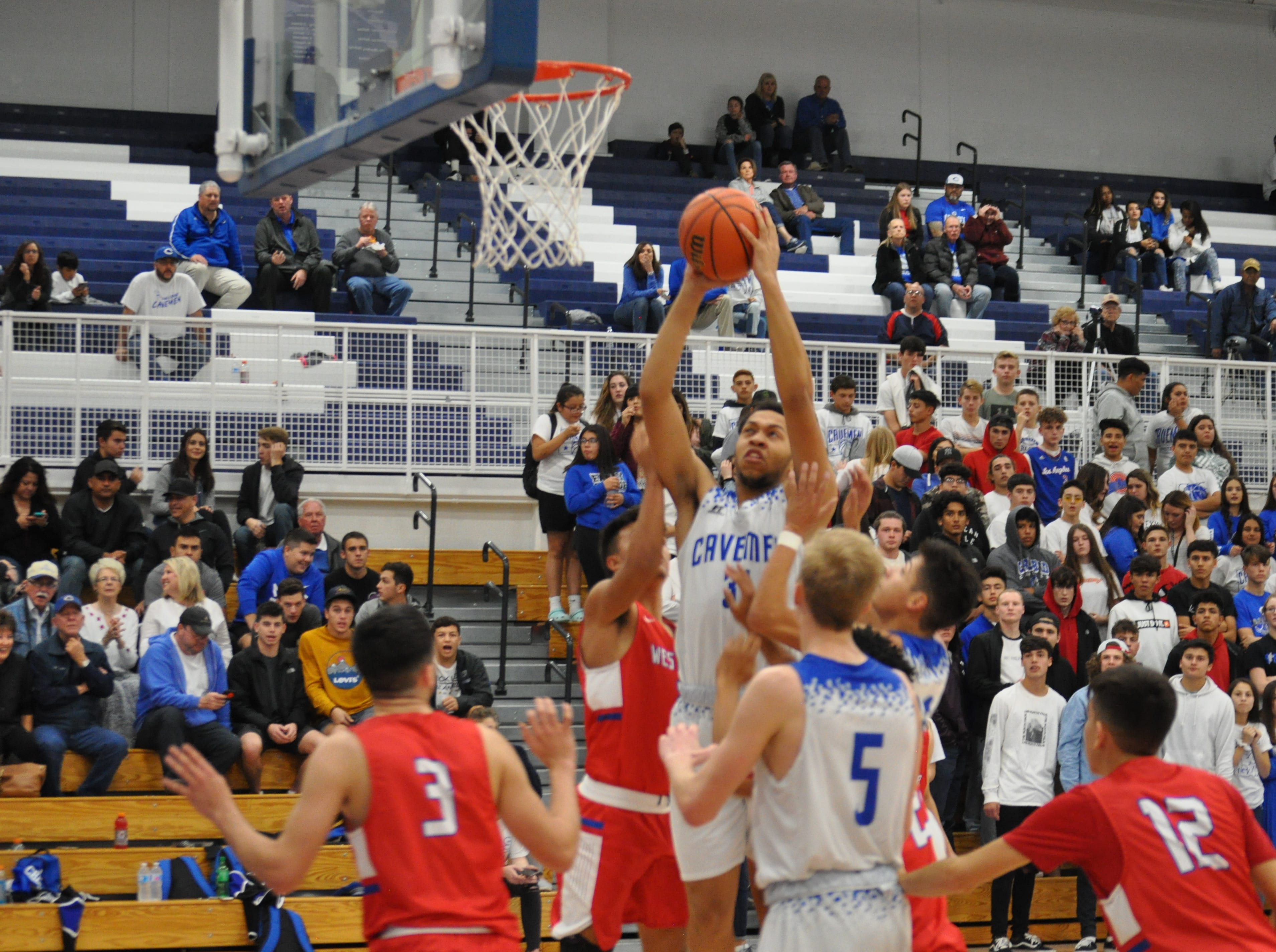 Carlsbad's Phillip Lee goes for a putback shot during Friday's game against West Mesa.