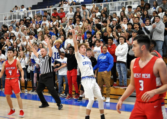 Josh Sillas and the crowd react to a made three-point shot in the second quarter of Friday's game against West Mesa. Sillas scored the last 10 points of the half for the Cavemen.