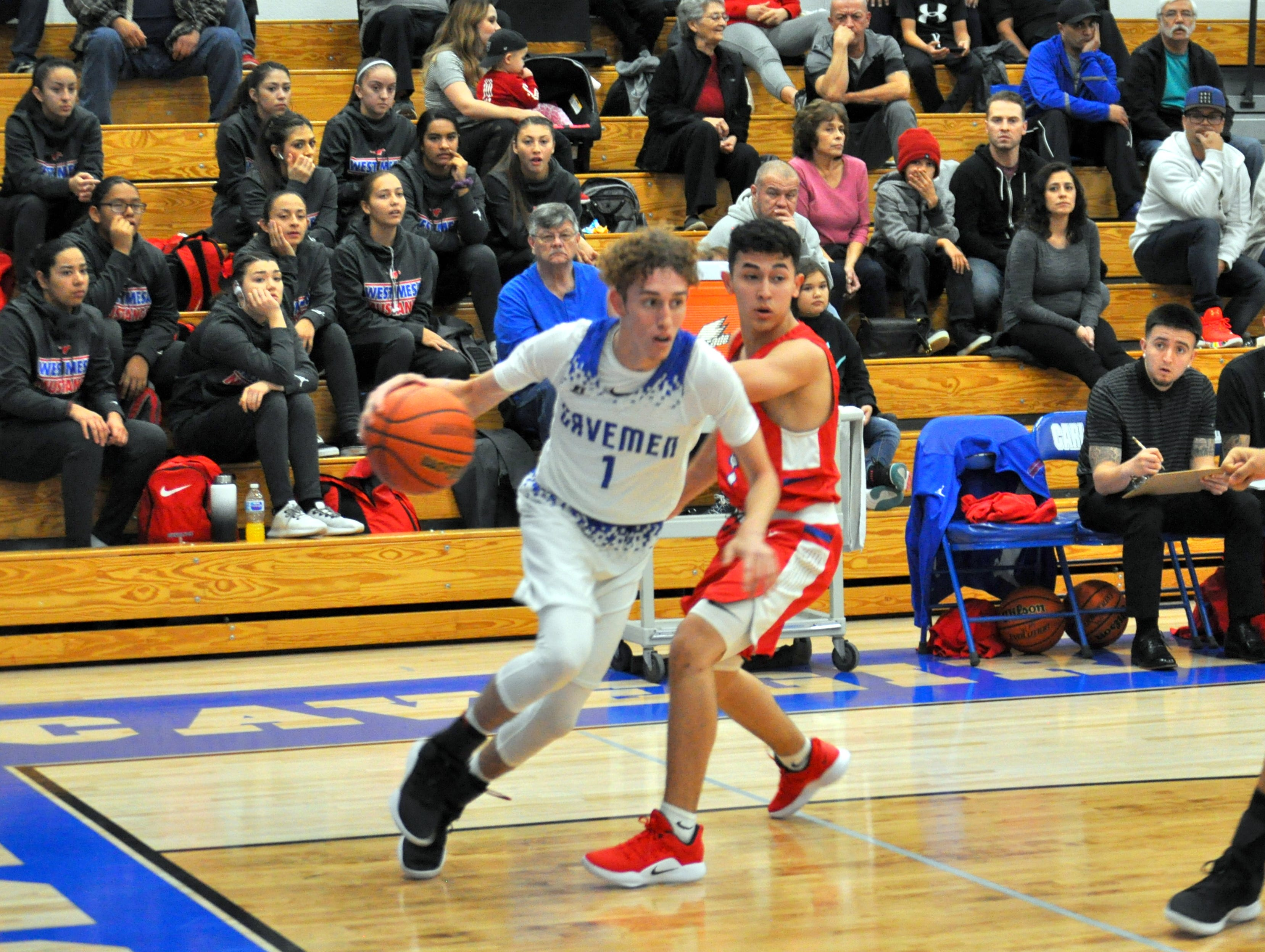 Josh Sillas drives to the lane during Friday's game against West Mesa.