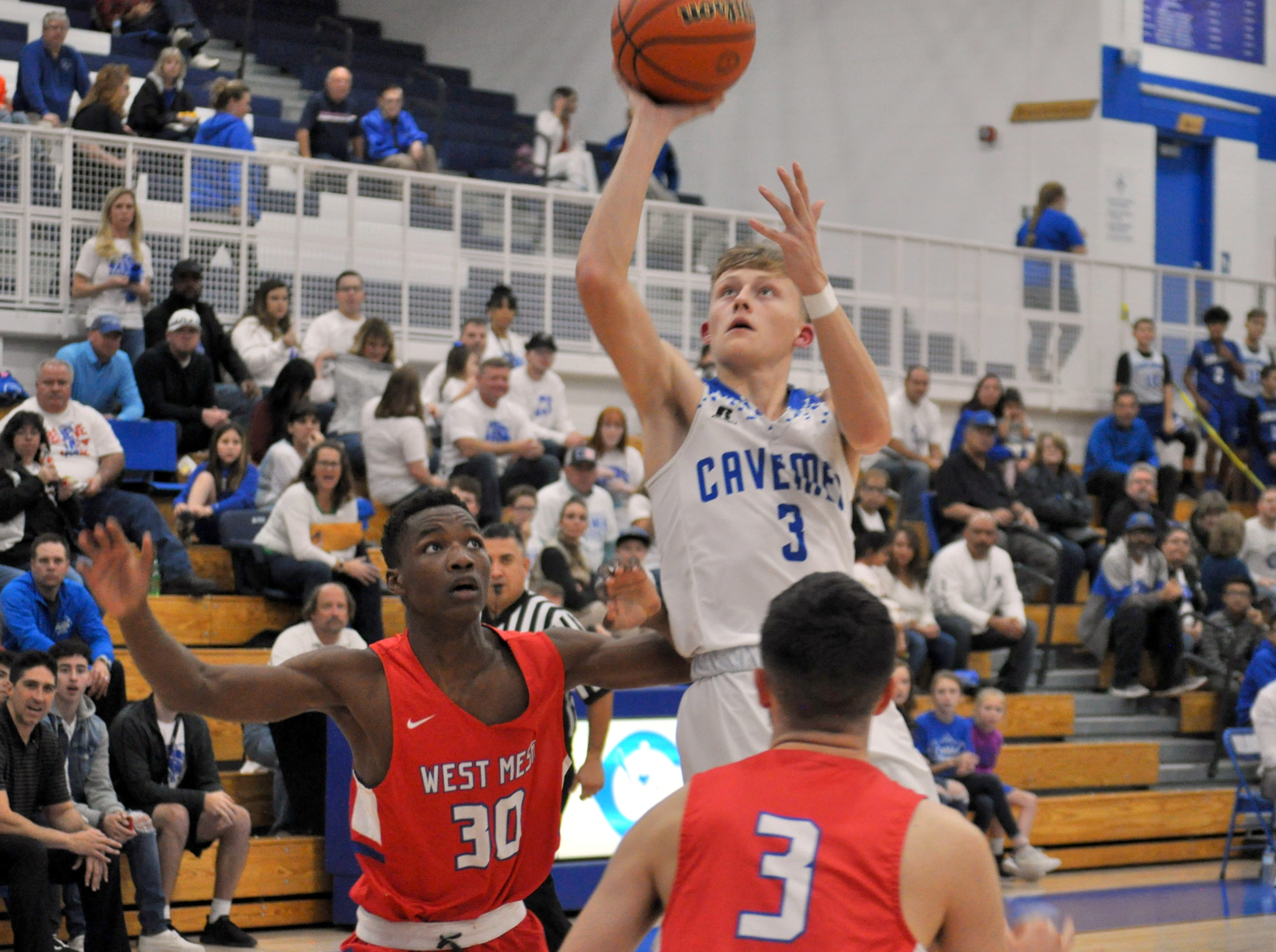 Carlsbad's Riley Hestand takes the first shot of Friday's game against West Mesa. Carlsbad won, 62-54.