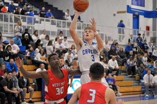 Carlsbad's Riley Hestand takes a contested shot against West Mesa on Dec. 14, 2018.