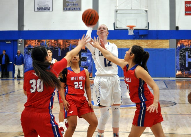 Carsyn Boswell takes a contested jump shot during Friday's game against West Mesa.