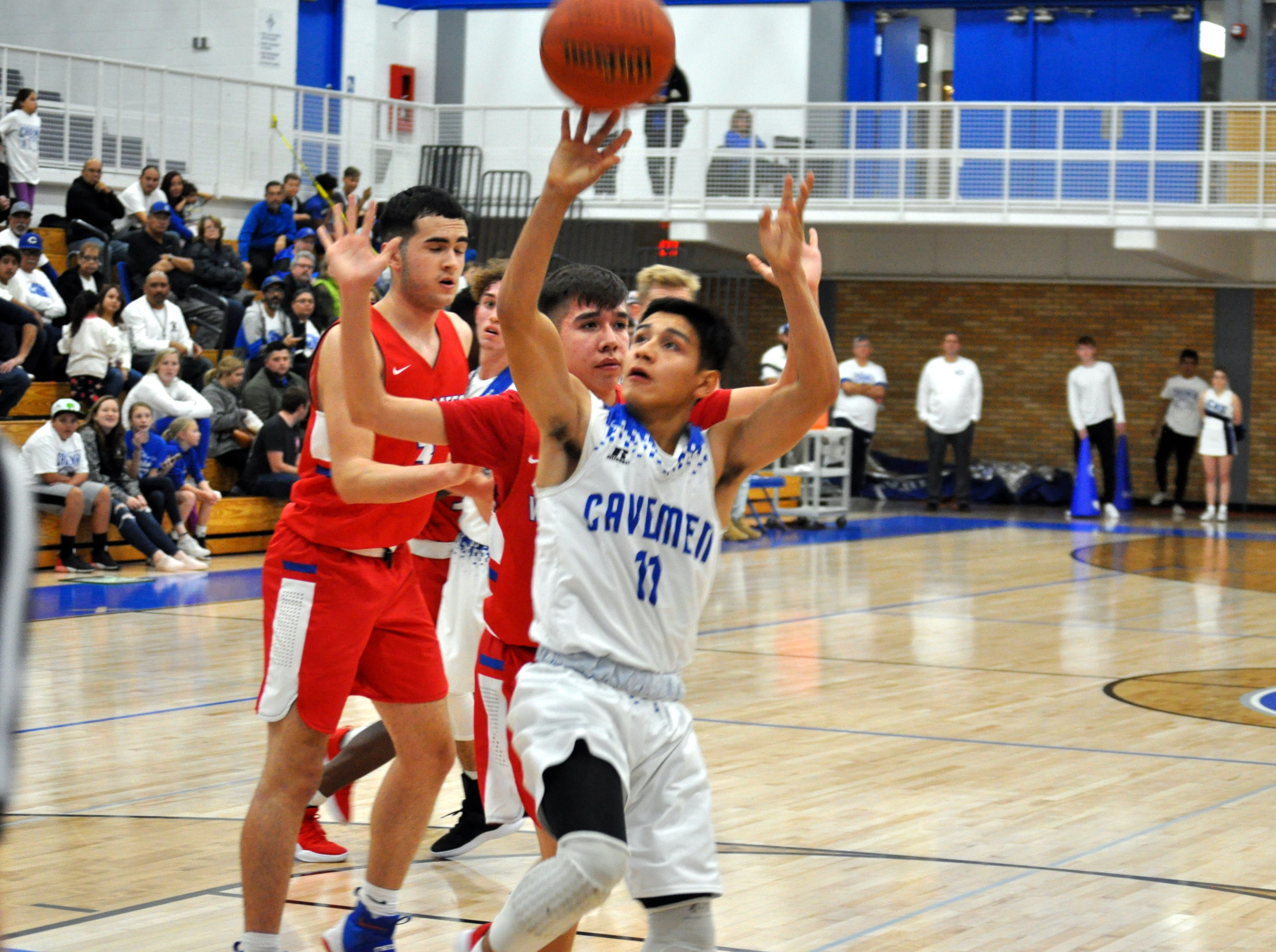 Edward Cano (11) gets off a shot during Friday's game against West Mesa.