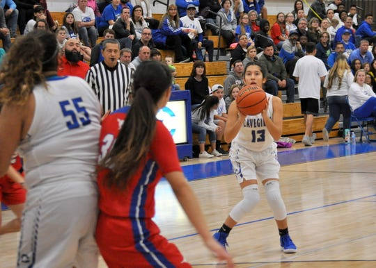 Tori Flores (13) takes a three-point shot during Friday's game against West Mesa.