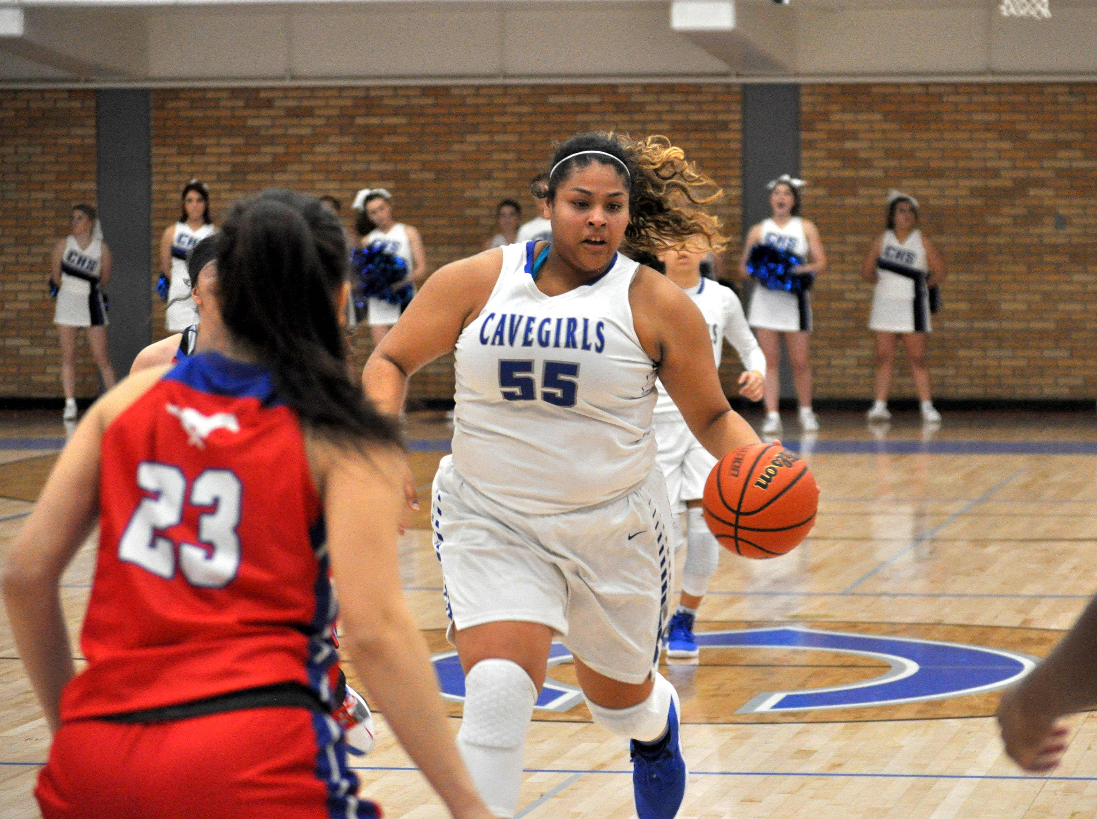 Kaliyah Montoya drives the lane during Friday's game against West Mesa.