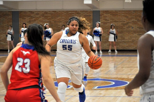 Kaliyah Montoya drives the lane against West Mesa in December 2018. In Carlsbad's three district games Montoya has 46 points, 14 assists, 14 steals, 13 rebounds and six blocks.