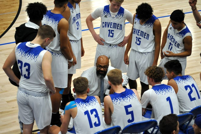 Jamaal Brown talks to his team during a timeout in Friday's game against West Mesa.